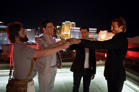 (L-R) Alan (ZACH GALIFIANAKIS), Stu (ED HELMS), Doug (JUSTIN BARTHA) and Phil (BRADLEY COOPER) in THE HANGOVER, a Warner Bros. Pictures release.  Photo by Frank Masi.